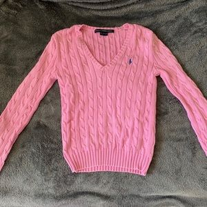 Pink cableknit sweater.